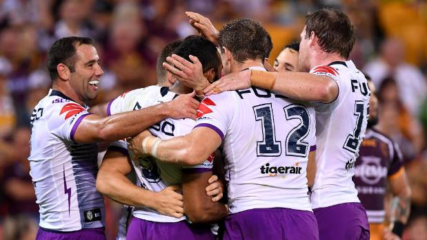 Melbourne Storm players celebrate a try by Billy Slater during Round 7 NRL win over the Brisbane Broncos.