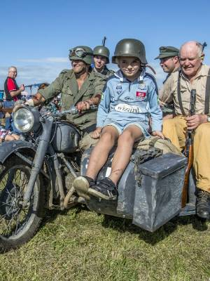 On a German sidecar motorcycle are Glen Hewison, left, Mitchell Soper, Tommi Hewison, 9, Antony Smith, and Rod Harvey at ...
