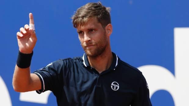 Tennis world No 140 Martin Klizan has beaten Novak Djokovic in the second round of the Barcelona Open