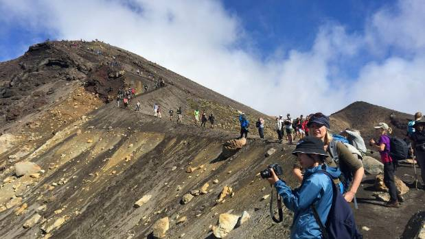 DOC continues to promote the Tongariro Alpine Crossing, despite up to 2700 people walking it on peak days - double the ...