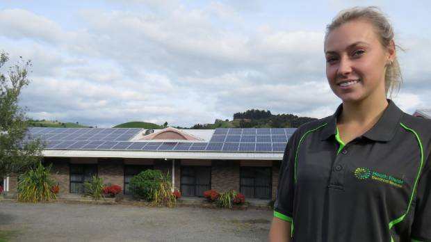 Jessica Bowring, lends a helping hand with the family business installing solar panels.