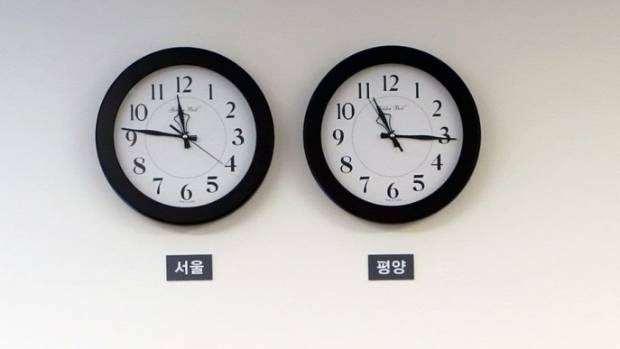 Clocks show time in Seoul left and Pyongyang at the Peace House in the demilitarised zone in the border village