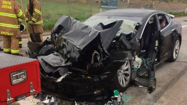 The Tesla Model S sedan crashed into the back of a Fire Department mechanic truck stopped at a red light in South