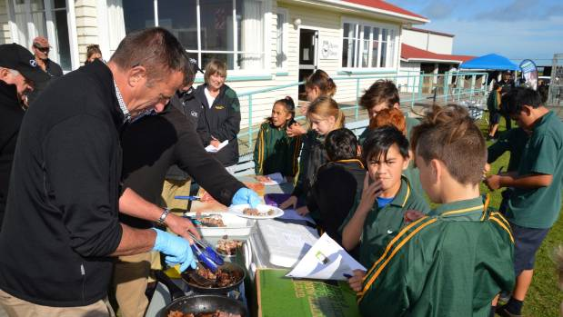 Brendon Kelly from Silver Fern Farms cooks meat for a blind taste test.