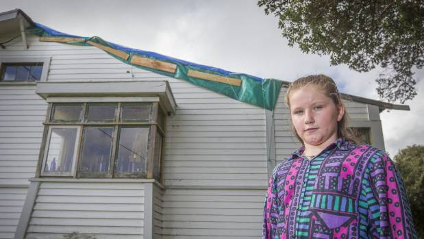 A month after the Taranaki tornado, the tarpaulin on the roof still scares 10-year-old Katie