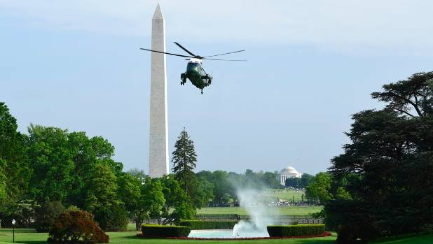 Marine One with Donald Trump on board prepares to land on the South Lawn of the White House after the US president