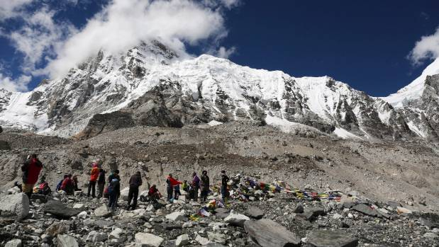 Trekkers rest at Everest Base Camp Nepal. A group of Nepalese sherpa guides reached the summit of Mount Everest fixing