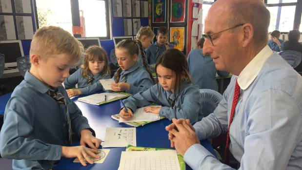 Michael Mercer with student Monty Fairbrother in one of the school's four learning hubs.