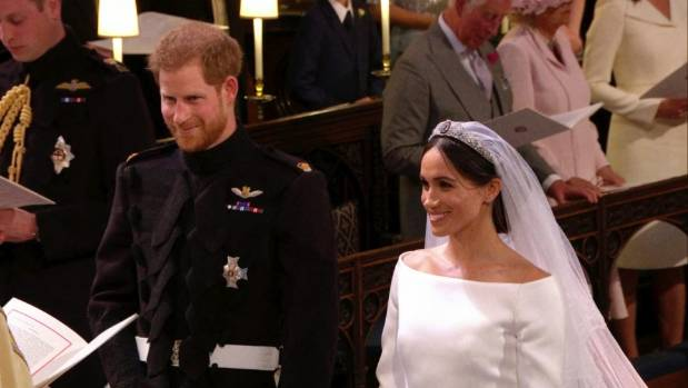 Prince Harry and Meghan Markle stand during their wedding ceremony.