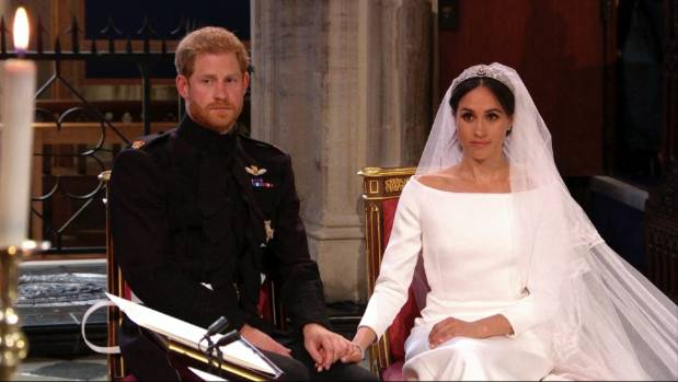 Prince Harry and Meghan Markle listen during their wedding ceremony.