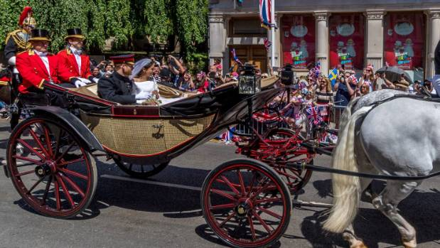 Prince Harry, Duke of Sussex and the Duchess of Sussex process through Windsor in the Ascot Landau carriage after ...
