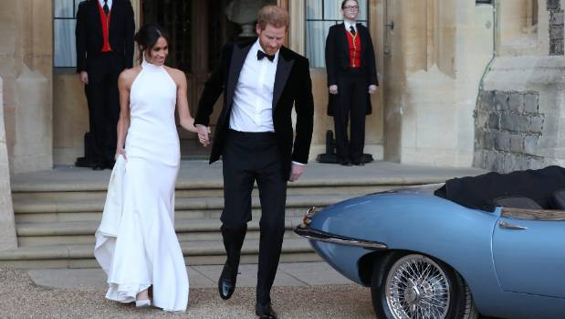Duchess of Sussex and Prince Harry, Duke of Sussex head for the E-Type at Windsor Castle, on their way to Frogmore House.
