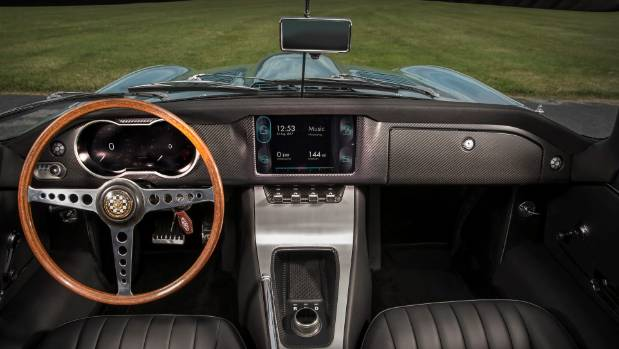Classic interior stays, but the instrument panel and centre console have digital screens.