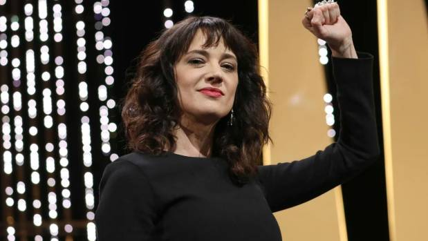 Argento gestures on stage during the closing ceremony of the Cannes Film Festival