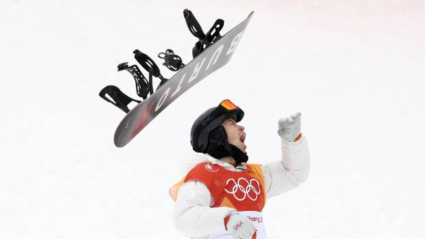 Snowboarder Shaun White reacts to winning the men's halfpipe for a third time at the Pyeongchang 2018 Winter Olympics.