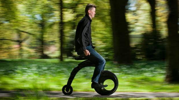 "Serial entrepreneur: Grant Ryan with his YikeBike, launched in 2009. An electric-powered ""mini-farthing""."