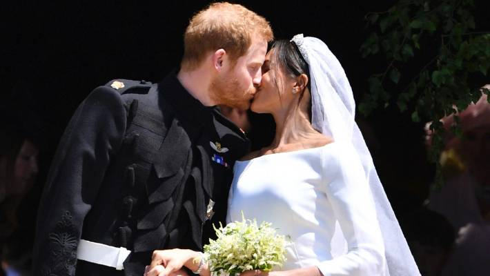 d34c5dff6a Britain s Prince Harry and his wife Meghan Markle kiss after their wedding  ceremony.