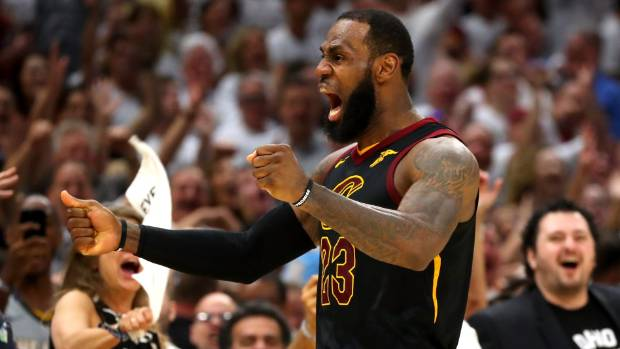 Cleveland Cavaliers forward Le Bron James roars in delight after nailing a three-pointer against the Boston Celtics