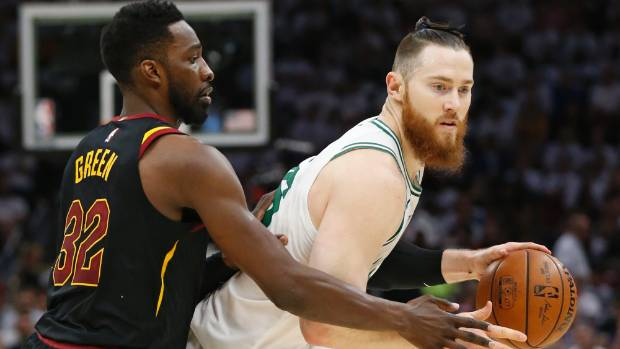 Boston Celtics Australian centre Aron Baynes right drives against Cleveland Cavaliers forward Jeff Green