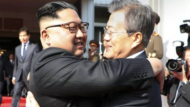 Kim Jong Un left and Moon Jae-in embrace each other after their surprise meeting on May 26
