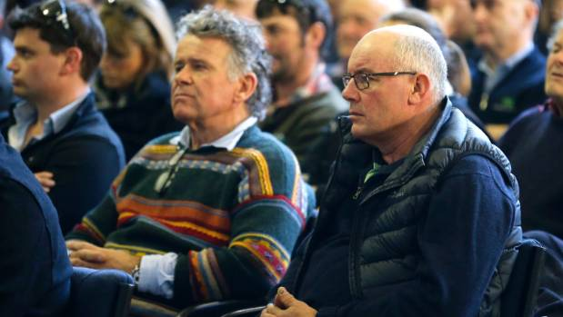 Farmers listen intently to an MPI presentation