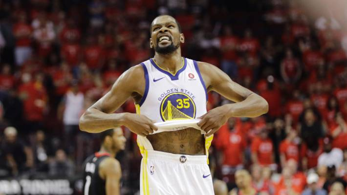 0aa3f4451c66 Golden State forward Kevin Durant shows his joy and stomach as the Warriors  beat the Rockets