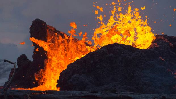About a dozen people trapped by Kilauea's lava, officials estimate