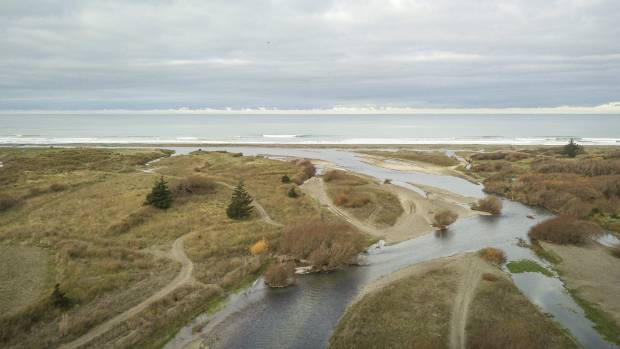 The braided river flows out to sea near Amberley.