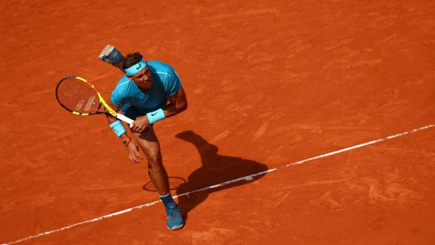Nadal's set streak ended by Schwartzman as rain halts clash