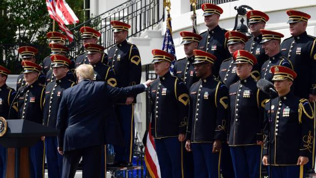 US President Donald Trump commends one of the US Army Chorus members at the Celebration of America at the White House