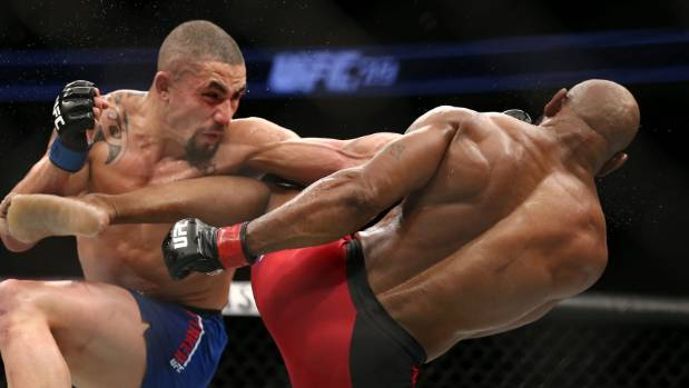 Robert Whittaker left punches Yoel Romero in their interim UFC middleweight championship bout Las Vegas last July