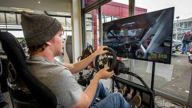 Hunter Haley got to the Kiwi Racing V8 exhibition on his skateboard and took on the challenge of the race simulator, at ...