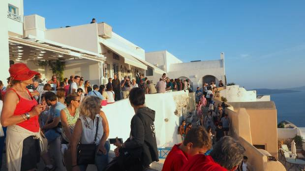 Crowds gather at Oia as sunset draws near.