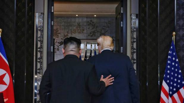 Kim and Trump leave the room after signing an agreement to denuclearise the Korean Peninsula.
