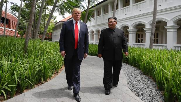 US President Donald Trump and North Korea leader Kim Jong Un walk from their lunch at the Capella resort.
