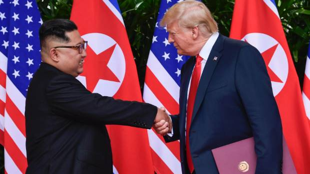 Kim Jong Un and Donald Trump shake hands during their historic summit in Singapore back in June