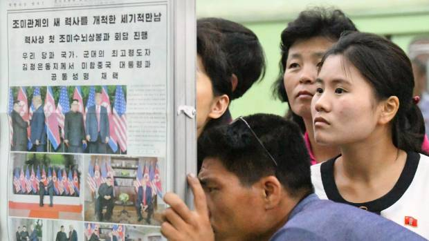 North Koreans gather round a newspaper stand at a subway station in the capital Pyongyang on Wednesday