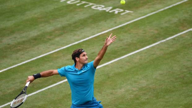 Roger Federer serves to Mischa Zverev in his straight-sets win in Stuttgart