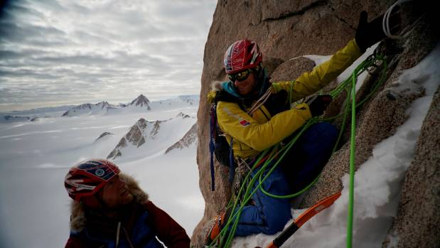 Leo (left) and Jean at a hanging below stance during the climb.