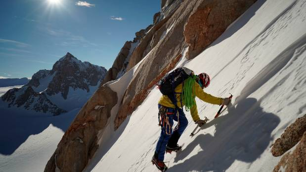 Jean climbs the 'easy' snow couloir on the Spectre.