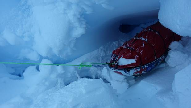 Leo's pulk being lifted out of the crevasse that threatened to claim it.