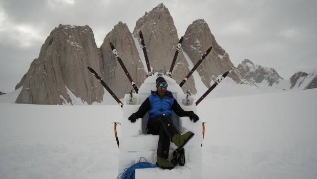King of the mountain: Mark on a throne of snow and ice in front of Antarctica's Organ Pipe Mountains.