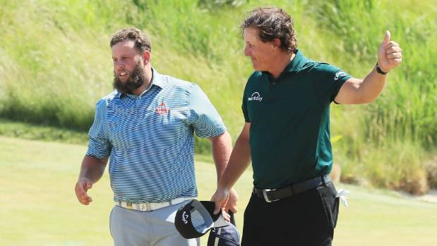 Frustrated Phil Mickelson swats moving ball with putter at US Open