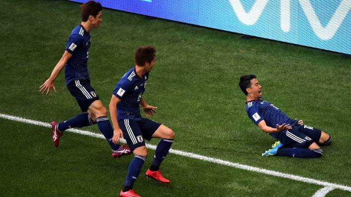 da2d7f23cb9 Shinji Kagawa of Japan celebrates scoring his team s first goal from the  penalty spot with Yuya