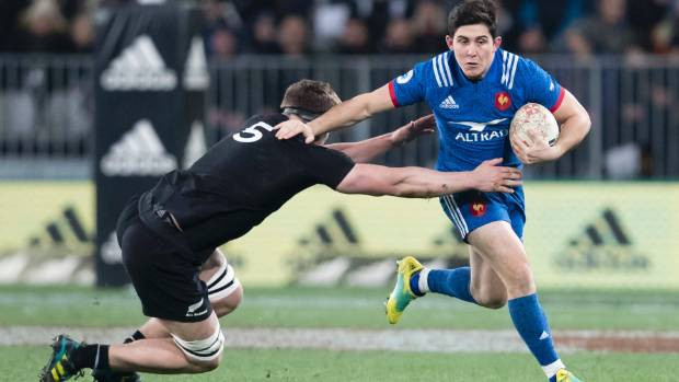 Scott Barrett makes one of his 19 tackles against France in Dunedin on Saturday night.