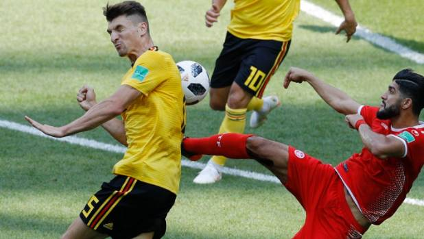 Tunisia's Ferjani Sassi right fights for the ball with Belgium's Jan Vertonghen left