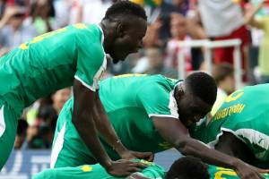 Senegal's players celebrate a goal during the World Cup group phase.
