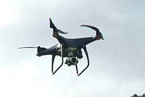Surveyor John Macfarlane takes a drone for a test flight.