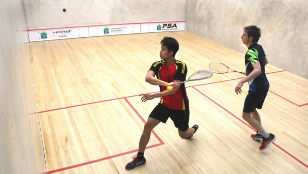 Ivan Yuen (left, Malaysia) eyes up a shot in his match with Rex Hedrick (Australia) in the final of the Southern PSA at ...