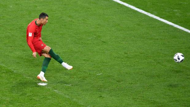 Cristiano Ronaldo of Portugal misses a penalty against Iran